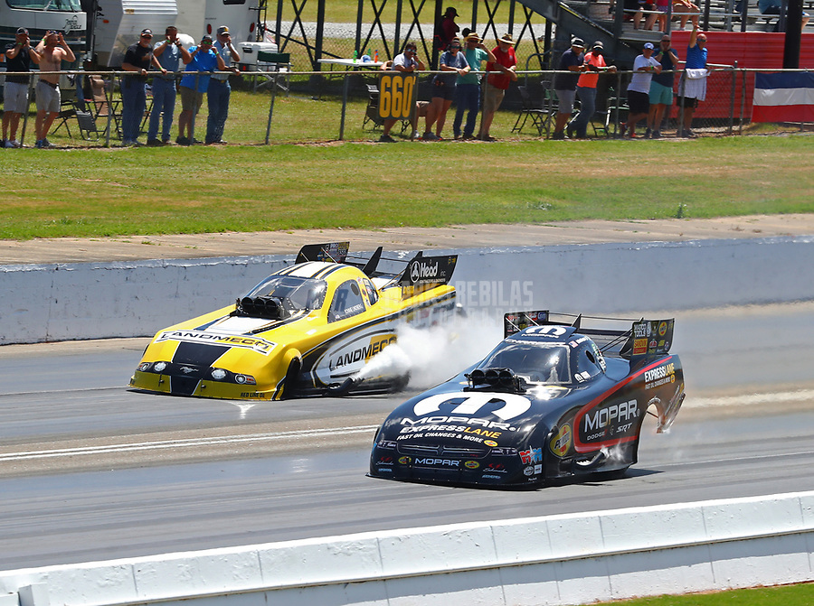 May 6, 2018; Commerce, GA, USA; NHRA funny car driver Matt Hagan (near) defeats Jonnie Lindberg during the Southern Nationals at Atlanta Dragway. Mandatory Credit: Mark J. Rebilas-USA TODAY Sports