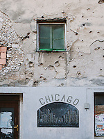 A bullet-riddled wall of a building at the old city of Mostar.