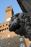 Detail of sculpture of Lion, 1600, by Flaminio Vacca or Vacchi (1538-1605), with Palazzo Vecchio in the background, Florence, Italy, pictured on June 8, 2007 in the late afternoon. The lion was made to match a Roman sculpture which originally stood by the staircase at the Villa Medici. When the Villa was sold by the Grand Duke of Tuscany the lions were moved to the Piazza della Signoria, Florence, where they flank the steps to the Loggia dei Lanzi. The Palazzo Vecchio, begun in 1299, was designed by Arnolfo di Cambio (1245-1302). Florence, capital of Tuscany, is world famous for its Renaissance art and architecture. Its historical centre was declared a UNESCO World Heritage Site in 1982. Picture by Manuel Cohen.