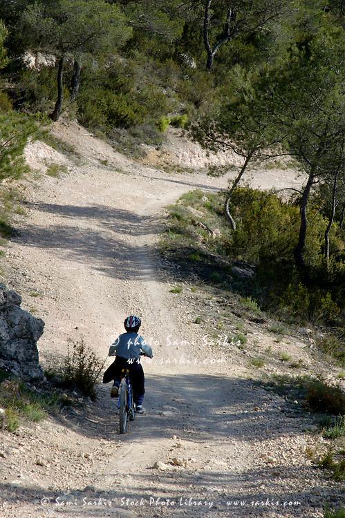 Boy Riding His Mountain Bike Alone On A Dirt Road Vitrolles