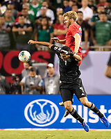 CHICAGO, IL - JULY 7: Tim Ream #13 and Raul Jimenez #9 go for the ball during a game between Mexico and USMNT at Soldiers Field on July 7, 2019 in Chicago, Illinois.