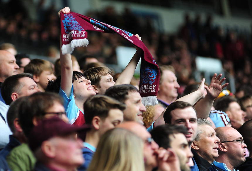 Burnley fans celebrate after Burnley's Danny Ings scored what proved to be the only goal of the game<br /> <br /> Photographer: Chris Vaughan/CameraSport<br /> <br /> Football - Barclays Premiership - Hull City v Burnley - Saturday 9th May 2015 - Kingston Communications Stadium - Hull<br /> <br /> &copy; CameraSport - 43 Linden Ave. Countesthorpe. Leicester. England. LE8 5PG - Tel: +44 (0) 116 277 4147 - admin@camerasport.com - www.camerasport.com