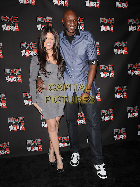 "KHLOE KARDASHIAN & LAMAR ODOM.The Axe Music ""One Night Only"" Concert series, Weezer headlines & takes over The Dunes Inn Motel in Hollywood, California, USA..September 21st, 2010 .full length married husband wife grey gray dress blue shirt jeans denim arm around waist tall short.CAP/RKE/DVS.©DVS/RockinExposures/Capital Pictures."