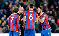 Luka Milivojevi? of Crystal Palace protests referee, Lee Mason's decisions during the EPL - Premier League match between Crystal Palace and Watford at Selhurst Park, London, England on 12 December 2017. Photo by Carlton Myrie / PRiME Media Images.