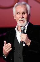 """20 March 2020 - Kenny Rogers, whose legendary music career spanned nearly six decades, has died at the age of 81. Rogers was inducted to the Country Music Hall of Fame in 2013."""" He had 24 No. 1 hits and through his career more than 50 million albums sold in the US alone. He was a six-time Country Music Awards winner and three-time Grammy Award winner. Some of his hits included """"Lady,"""" """"Lucille,"""" """"We've Got Tonight,"""" """"Islands In The Stream,"""" and """"Through the Years."""" His 1978 song """"The Gambler"""" inspired multiple TV movies, with Rogers as the main character. File Photo: September 20, 2010 - Nashville, TN - Kenny Rogers. The Academy of Country Music held their annual Honors event at the Ryman Auditorium, where various artists performed during the show in honor of some of the reipients. Photo Credit: Dan Harr/AdMedia"""