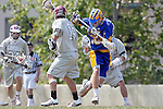 Los Angeles, CA 04/11/09 -  Greg Sharron (LMU #18) looks on as Patrick Sullivan (UCSB#15) tries to find the lose ball during the UCSB-LMU Men's Lacrosse game played at Loyola Marymount University's Leavey Field.