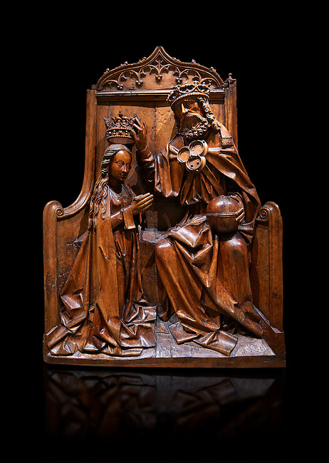 Gothic wood relief sculpture of the crwoning of of the Virgin Mary in the central European sgchiool style, end of 15th Century.  National Museum of Catalan Art, Barcelona, Spain, inv no: MNAC  5270. Against a black background.