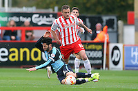 Joe Jacobson of Wycombe Wanderers is fouled by Dean Parrett of Stevenage during the Sky Bet League 2 match between Stevenage and Wycombe Wanderers at the Lamex Stadium, Stevenage, England on 17 October 2015. Photo by PRiME Media Images.