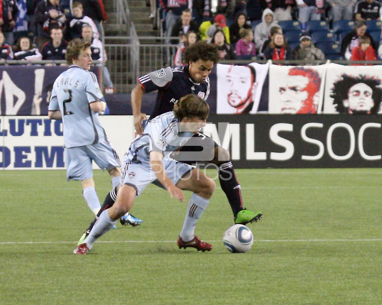 Colorado Rapids midfielder Wells Thompson (15) and New England Revolution defender Kevin Alston (30) compete for the ball in the midfield.  The Colorado Rapids defeated the New England Revolution, 2-1, at Gillette Stadium on April 24.2010