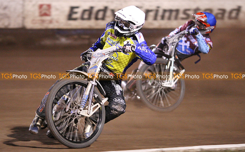 Heat 15: Bjarne Pedersen (white) and Jonas Davidsson (blue) - Lakeside Hammers vs Eastbourne Eagles, Elite League Speedway play-off semi-final at the Arena Essex Raceway, Purfleet - 19/09/11 - MANDATORY CREDIT: Rob Newell/TGSPHOTO - Self billing applies where appropriate - 0845 094 6026 - contact@tgsphoto.co.uk - NO UNPAID USE.
