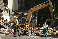 Rescue workers search for victims and clear debris from a building that collapsed in an apparent accident at a demolition site, in Philadelphia, Pennsylvania June 05, 2013 by Kena Betancur / VIEWpress