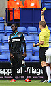 Roarie Deacon of Stevenage is booked by referee Craig Pawson<br />  - Tranmere Rovers v Stevenage - Sky Bet League One - Prenton Park, Birkenhead - 7th September 2013. <br /> © Kevin Coleman 2013