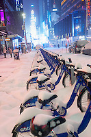 "CitiBikes covered in snow during a snow storm on Tuesday evening, January 21, 2014. The official snowfall in Central Park was 11 inches (28 centimeters) which was a record for the day.  Brutal ""Polar Express"" temperatures in the single digits accompanied the snow with the arctic temperatures expected to last several days.  (© Richard B. Levine)"