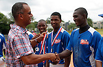 Moises Alou (L) gives medals to the winners at the end of the tournament in Boca Chica August 8, 2011 the tournament called Torneo Supremo which aims to maximize the ability of Major League Baseball organizations to scout in the Dominican Republic. El Torneo Supremo will consist of four teams playing one game per week in addition to a mid-tournament All-Star event, as well as championship and consolation games. Tournament participants will also be provided in-classroom education opportunities. April 2011. ViewPress/ ZZ