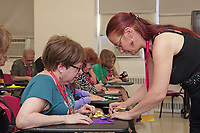 New York, NY, USA - June 24-25, 2017: OrigamiUSA 2017 Convention at St. John's University, Queens, New York, USA. Daniela Carboni, Italy, teaches a class how to fold her model Lotus Flower from a Muddy Pond.