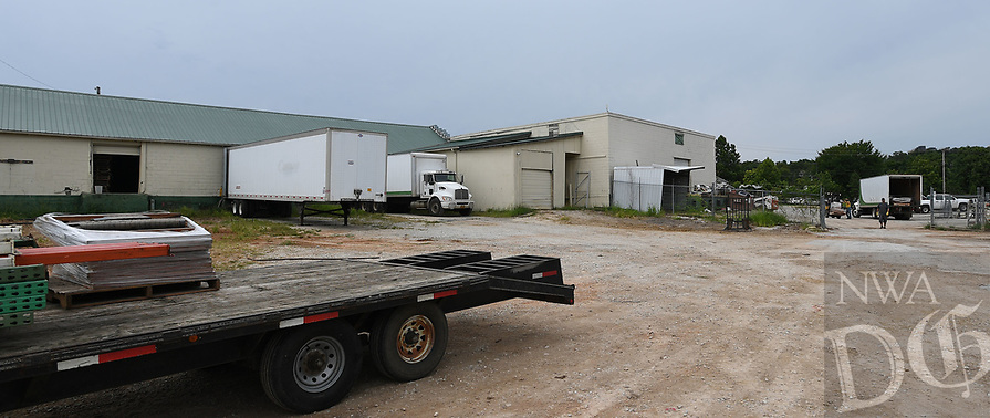 NWA Democrat-Gazette/J.T. WAMPLER  Employees move inventory and equipment Thursday August 8, 2019 at the former Farmers Cooperative building on Martin Luther King Jr. Blvd. The business will reopen in Farmington.<br /><br />Specialized Real Estate Group bought the property this year and plans to put in more than 200 apartments and renovate the existing properties for a mix of restaurants, entertainment, office and retail space.