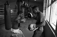 21 year old boxer John Akauola is pictured training at the Parmatta PCYC. Sydney Australia. He trains with his twin brother Luke, 3 year old sister Retina and is coached by his mother Polly.<br /> Pictures James Horan