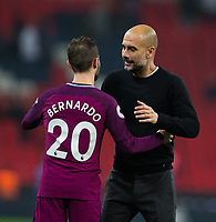 Manchester City manager Josep Guardiola celebrates with Manchester City's Bernardo Silva <br /> <br /> Photographer Craig Mercer/CameraSport<br /> <br /> The Premier League - Tottenham Hotspur v Manchester City - Saturday 14th April 2018 - Wembley Stadium - London<br /> <br /> World Copyright &copy; 2018 CameraSport. All rights reserved. 43 Linden Ave. Countesthorpe. Leicester. England. LE8 5PG - Tel: +44 (0) 116 277 4147 - admin@camerasport.com - www.camerasport.com