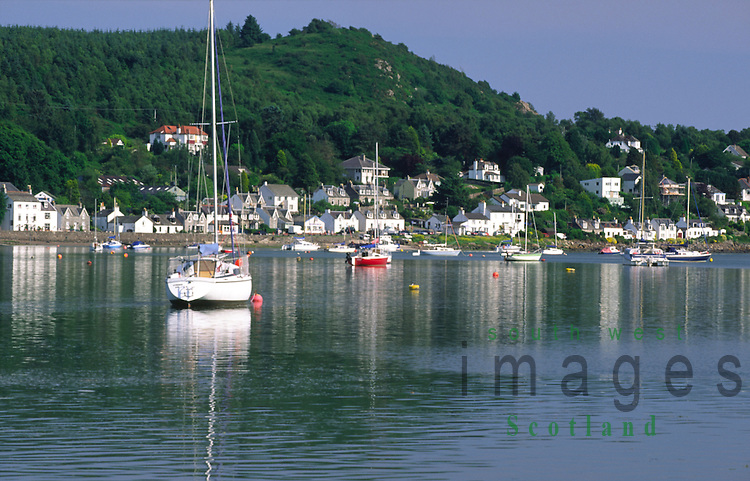 Yachts moored on the River Urr looking across to Kippford Motte of Mark and Mark Hill on the Solway Firth coast Scotland UK