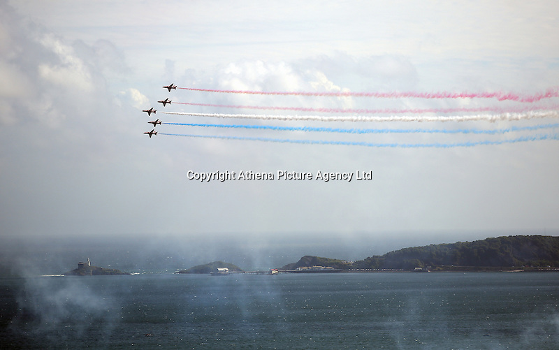 Swansea, UK. Saturday 02 July 2016<br /> Aeroplanes of the Red Arrows perform aerobatic maneuvers and fly over Swansea Bay as part of the Swansea Air Show.
