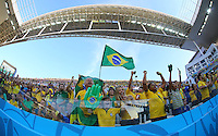 Brazil fans cheer inside the Itaquerao stadium as their players come out to warm up