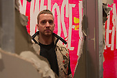 London, UK. 7 October 2015. Pictured: artist Eddie Peake. Eddie Peake: The Forever Loop opens in the Curve gallery/Barbican Centre on 9 October 2015 and runs until 10 January 2016. In this free exhibition, artist Eddie Peake presents installations, choreographed performance of nude male and female dancers and video set-ups. EDITORIAL USE IN CONNECTION WITH THE EXHIBITION.