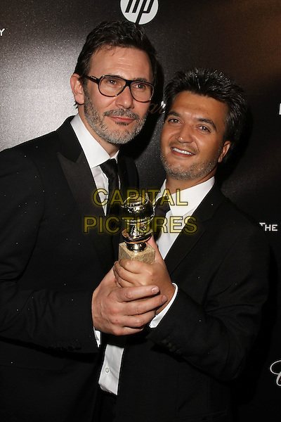Michel Hazanavicius, Thomas Langmann.The Weinstein Company 2012 Golden Globe Awards After Party held at  Bar 210 at the Beverly Hilton Hotel, Hollywood, California, USA..January 15th, 2012.globes half length black suit jacket tie white shirt glasses facial hair award trophy winner beard stubble.CAP/ADM/CH.©Charles Harris/AdMedia/Capital Pictures