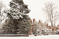 Winter snow makes the old brick buildings of the town of Oxford hushed and magical.