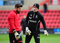 Lincoln City's Josh Vickers, left, and Lincoln City's first team goalkeeping coach Andy Warrington<br /> <br /> Photographer Andrew Vaughan/CameraSport<br /> <br /> The EFL Sky Bet League Two - Swindon Town v Lincoln City - Saturday 12th January 2019 - County Ground - Swindon<br /> <br /> World Copyright &copy; 2019 CameraSport. All rights reserved. 43 Linden Ave. Countesthorpe. Leicester. England. LE8 5PG - Tel: +44 (0) 116 277 4147 - admin@camerasport.com - www.camerasport.com