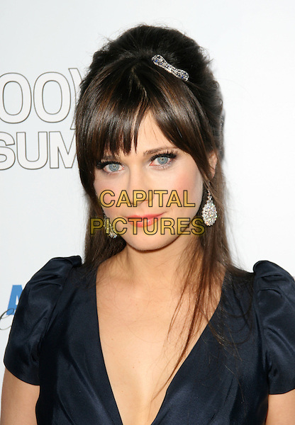 "ZOOEY DESCHANEL .The Fox Searchlight L.A. Premiere of ""(500) Days of Summer"" held at The Egyptian Theatre Theatre in Hollywood, California, USA. .June 24th, 2009.headshot portrait dangling silver earrings clip hair accessory fringe bangs up do updo hair black navy blue.CAP/DVS.©Debbie VanStory/Capital Pictures."