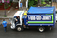 A 1-800-got-junk? truck is doubled parked on Avenue Cartier in Quebec city June 28, 2009. 1-800-GOT-JUNK? is a full-service junk removal company with over 220 franchises in Canada, the United States and Australia.
