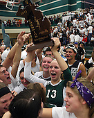 Shannon Murdock, Lake Orion, holds up the regional championship trophy and celebrates with teammates and fans following the Dragons three game sweep over Troy at Lake Orion Thursday, Nov. 10, 2011.