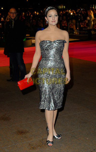 """DREW BARRYMORE.Attends the UK Premiere of """"Music & Lyrics"""",.Odeon Leicester Square, .London, England, February 5th 2006..full length strapless grey and black lace dress red clutch bag hands bow shoes hairband hair band .CAP/CAN.©Can Nguyen/Capital Pictures"""