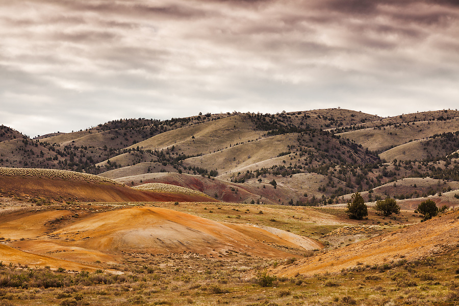 Light rain clouds form over the Painted Hills section of the John Day Fossil Beds National Monument in Wheeler County, Oregon.