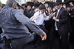 Ultra-Orthodox Jews clash with police in the streets of Jerusalem, Saturday, June 6, 2009. A few thousand Ultra-Orthodox Jews took to the streets on Saturday to protest the Jerusalem municipality's plan to allow for the city hall's parking lot to be open on the Jewish Sabbath. The demonstrators clashed with police forces, and hurled garbage, glass and stones at police and at members of the press. <br /> Photo By : Emil Salman / JINI