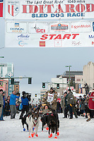 Rick Casillo and team leave the ceremonial start line with an Iditarider at 4th Avenue and D Street in downtown Anchorage, Alaska on Saturday, March 5th during the 2016 Iditarod race. Photo by Joshua Borough/SchultzPhoto.com