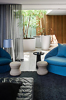 The living space embraces the notion of casualness through its relaxed and laid back décor. Cool blues and grays give the room a calm ambiance. The room opens out seamlessly to an outdoor terrace area.