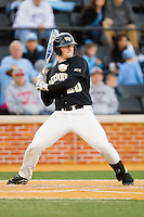 Jack Carey (20) of the Wake Forest Demon Deacons gets out of the way of an inside pitch during the game against the North Carolina Tar Heels at Wake Forest Baseball Park on March 9, 2013 in Winston-Salem, North Carolina.  The Tar Heels defeated the Demon Deacons 20-6.  (Brian Westerholt/Four Seam Images)