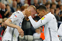 ( L-R) Oli McBurnie of Swansea City celebrates his second goal with team mate Martin Olsson during the Sky Bet Championship match between Swansea City and Leeds United at the Liberty Stadium, Swansea, Wales, UK. Tuesday 21 August 2018