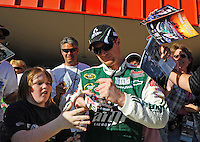 Feb 20, 2009; Fontana, CA, USA; NASCAR Sprint Cup Series driver Dale Earnhardt Jr signs autographs during qualifying for the Auto Club 500 at Auto Club Speedway. Mandatory Credit: Mark J. Rebilas-