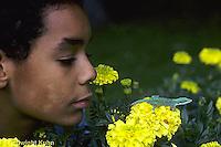 1R06-093z  Green Anole - boy watching anole jump from marigold flower - Anolis carolinensis
