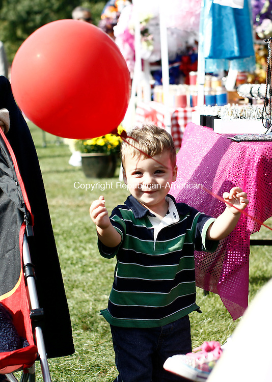 Watertown, CT- 20 September 2014-092014CM01-  Christian Desjardins, 17 months, of Watertown, plays with a balloon during the 36th annual Watertown Fall Festival on Saturday. Desjardins, who was with his parents Michael and Angela Desjardins were among the hundreds of people who attended the festival at Veterans Memorial Park.  The event featured food, crafts, a magic show, music, various vendors and more.     Christopher Massa Republican-American
