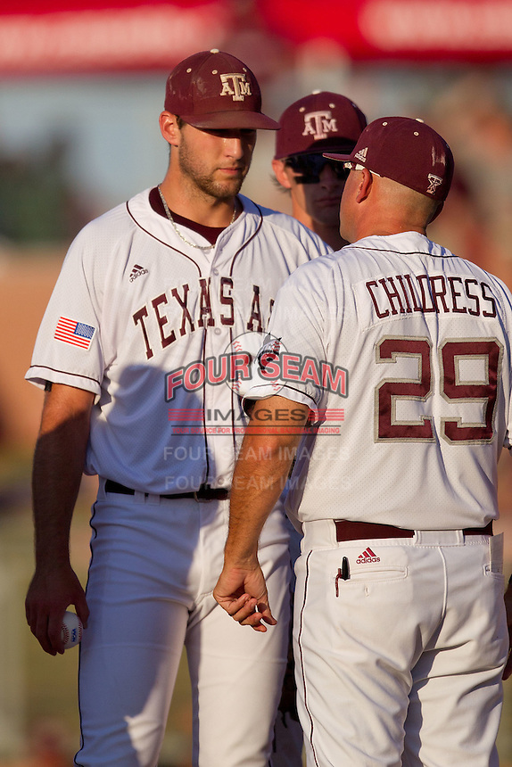 Texas A&M Aggie starting pitcher Michael Wacha #38 talks with manager Rob Childress #29 during the NCAA Tournament Regional baseball game against the Dayton Flyers on June 1, 2012 at Blue Bell Park in College Station, Texas. The Aggies defeated the Flyers 4-1. (Andrew Woolley/Four Seam Images).