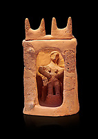 Minoan clay model shrine depicting a priestess playing the part of a goddess in a small single roomed house, Galatas 1700-1650 BC; Heraklion Archaeological  Museum, black background.