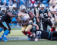 The Carolina Panthers played the San Francisco 49ers at Bank of America Stadium in Charlotte, NC in the NFC divisional playoffs on January 12, 2014.  The 49ers won 23-10.  San Francisco 49ers running back Kendall Hunter (32), Carolina Panthers defensive tackle Linden Gaydosh (98)