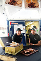 NOLA BBQeaux serves BBQ at the  Westbank Nawlins Flea Market. Tuan Huyhn and Sang Phan of NOLA BBQeaux