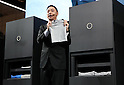 "October 4, 2016, Chiba, Japan - Japan's Seven Dreamers Laboratories president Shinichi Sakane displays the world's first automatic laundry folding machine ""Laundroid 1"" which will go on sale next year at the CEATEC Japan 2016 in Chiba, suburban Tokyo on Tuesday, October 4, 2016. Asia's largest electronics trade show CEATEC started here through October 7.   (Photo by Yoshio Tsunoda/AFLO) LWX -ytd-"