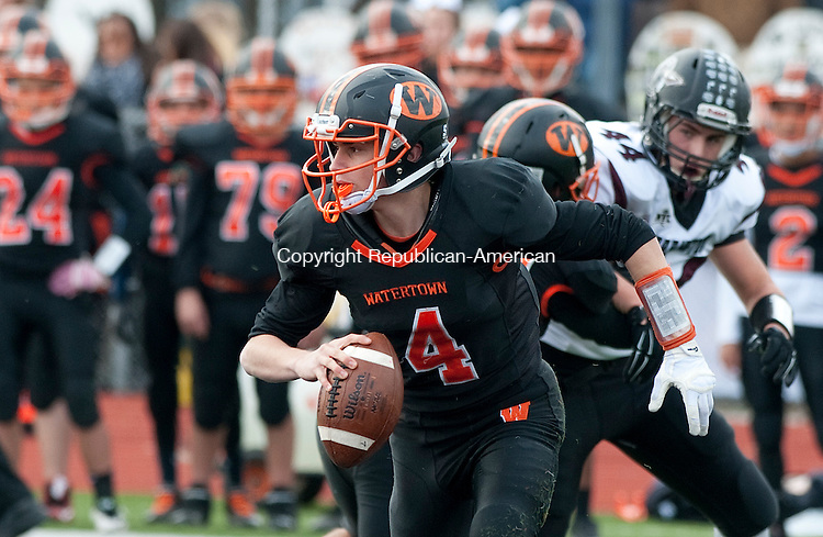 WATERTOWN, CT--- -112265JS16-Watertown's Nick D'Elia (4) scrambles while looking for a receiver  during their Thanksgiving day game against Torrington Thursday at Watertown High School. <br /> Jim Shannon Republican-American