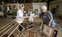 NWA Democrat-Gazette/BEN GOFF @NWABENGOFF<br /> Sharon McCarver (left), owner of The Rose Antique Mall and Flea Market in Rogers, and Sybil Abrahamsen, both of Rogers, help set up a display at the entrance Wednesday, April 10, 2019, while preparing for Vintage Market Days Northwest Arkansas at the Benton County Fairgrounds in Bentonville. Vintage Market Days, with rustic repurposed furniture and decor items, original arts, crafts, clothing and food trucks will be open Friday through Sunday.