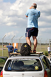 Pix: Shaun Flannery/shaunflanneryphotography.com...COPYRIGHT PICTURE>>SHAUN FLANNERY>01302-570814>>07778315553>>..7th May 2011........... A 'plane spotter' at Robin Hood Airport Doncaster Sheffield stood on the roof of his car awaiting the arrival of Vulcan xh558.